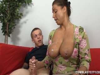 a busty mature lady jerks off a short man 1