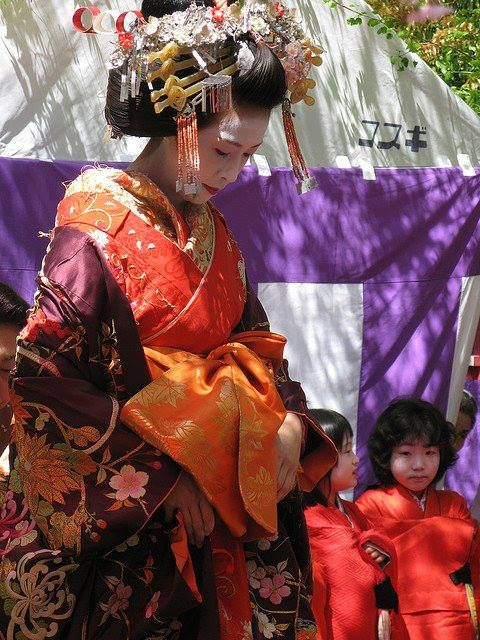 a woman dressed as a tayuu along with two kamuro japanese geishajapanese