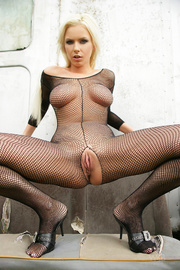 blonde wears fishnet catsuit year ago pics youx