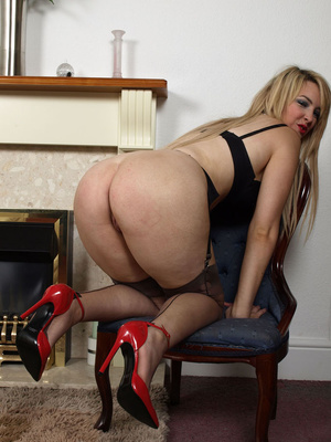 british red heels hot blonde milf in red shoes taking off her dress