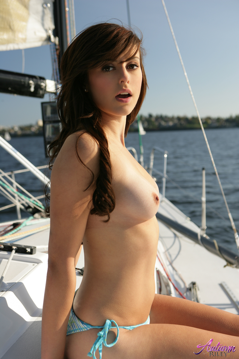 Teen girls naked on a boat