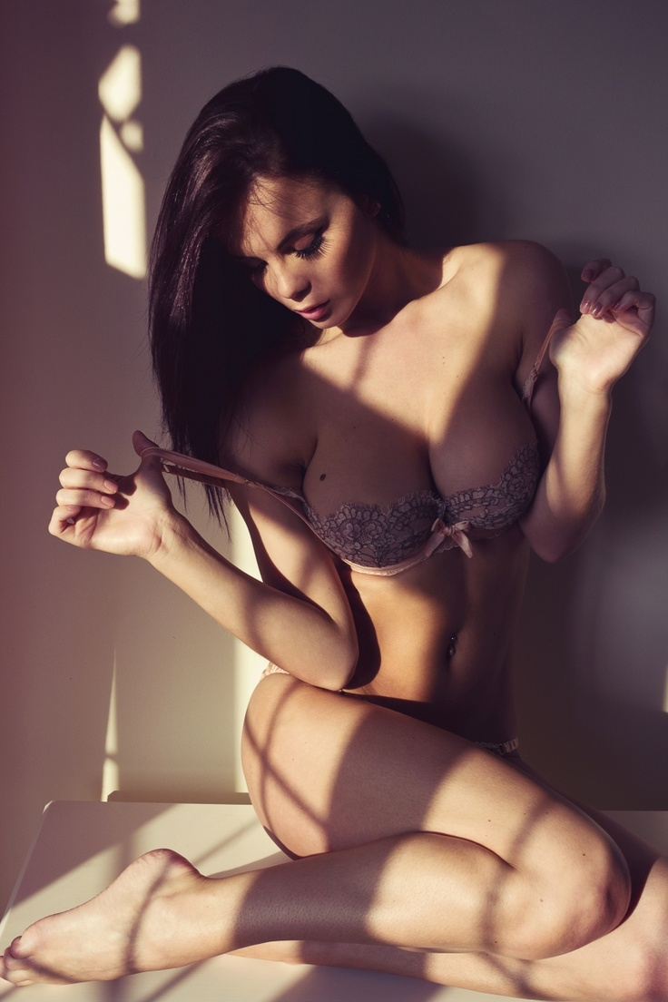 busty brunette under the light shadow shadows photography lingerie