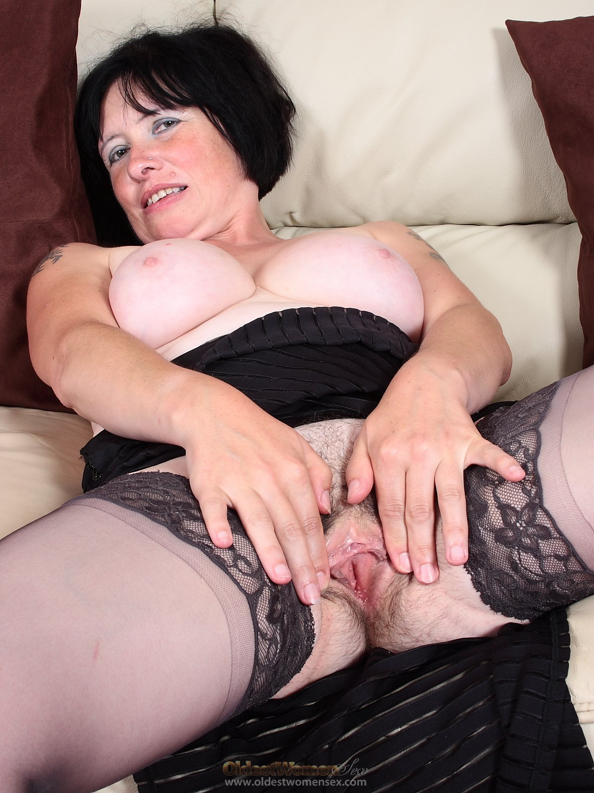 cute old woman in black dress shows hairy pussy