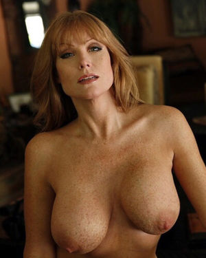 freckled redheaded milf with massive udders to suckle
