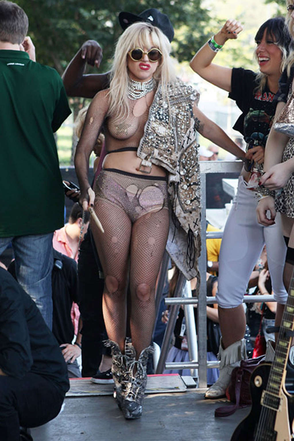lady gaga with tape covering her nipples in see thru top on stage 1