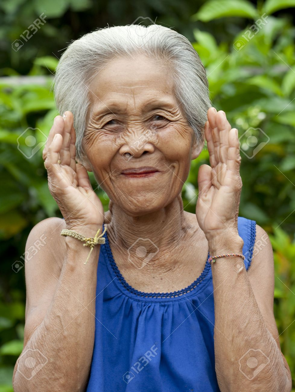 portrait old asian woman with gestures stock photo