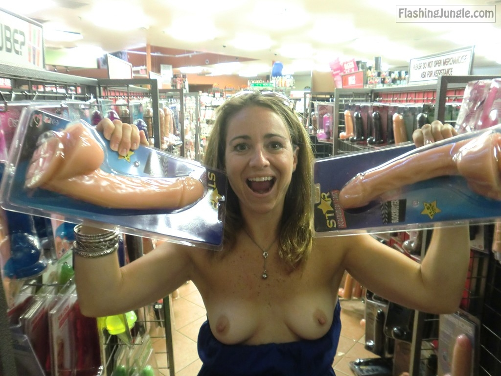 Hot chick flashes tits in store