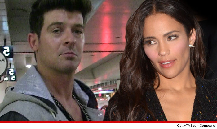 robin thicke desperate flight to canada to save marriage