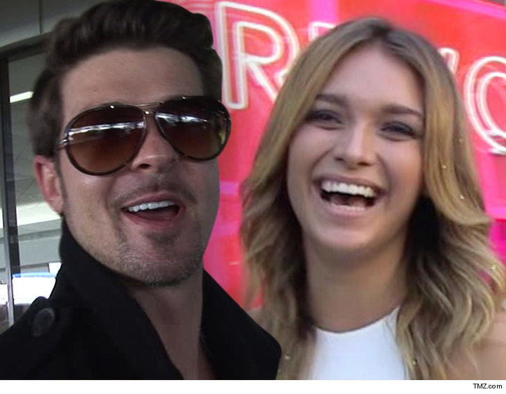 robin thicke is about to be a father again with a girlfriend who is barely able to legally drink