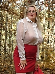 sexy secretary enjoying a picnic in the woods a see thru blouse some upskirt