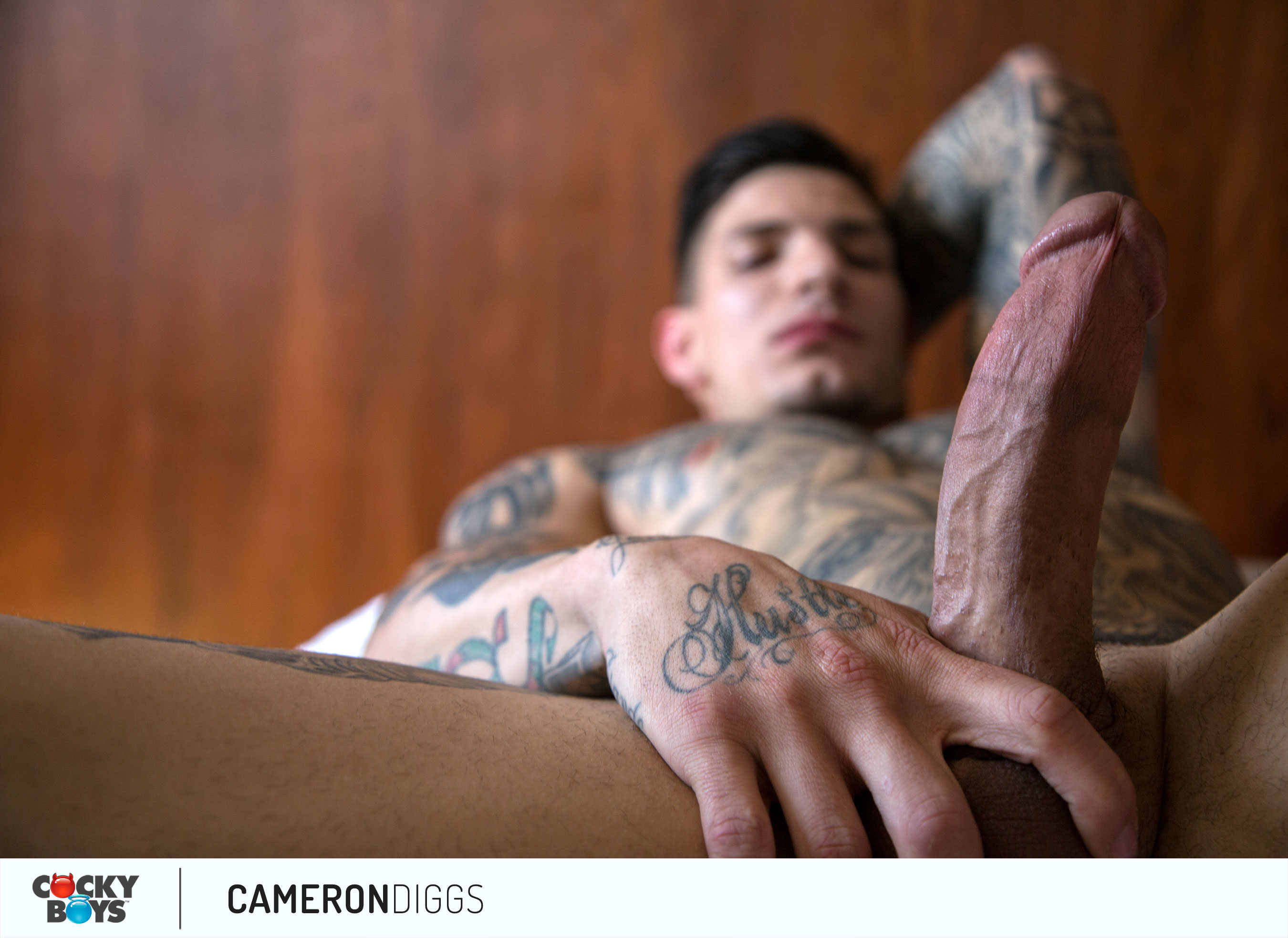 tattoed god cameron diggs from cockyboys