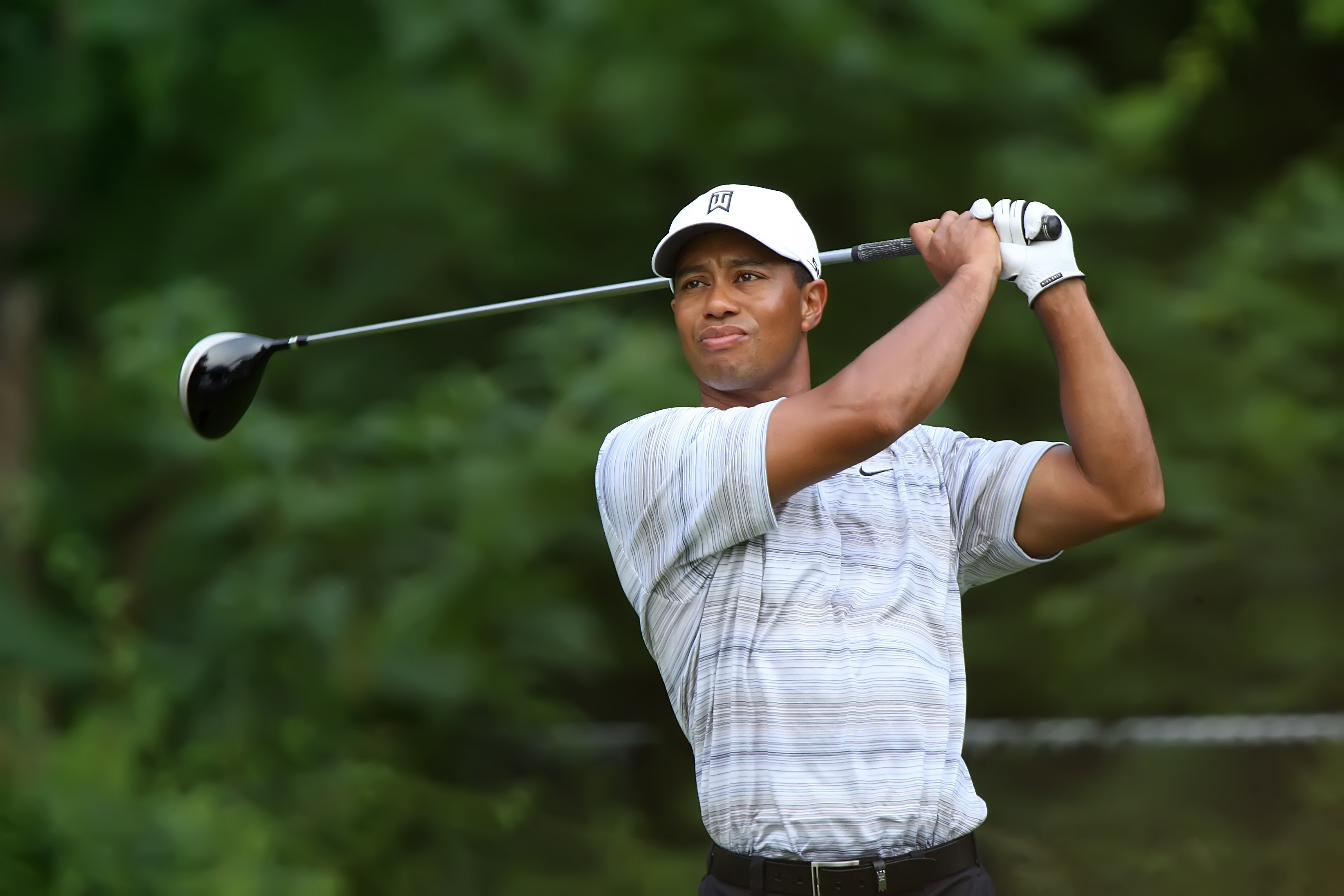 tiger woods an african american male in his early looks serious