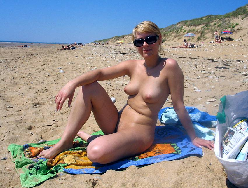 young exhibitionists sunbathing nude on the beach outdoor sex
